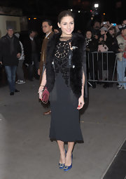 The always sophisticated Olivia Palermo channeled the '40s at the premiere of 'W.E.' in an elegant black dress, accessorized with a dark red Bayswater chain strap clutch.