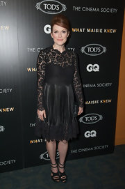 Julianne Moore's LBD featured lace long sleeves and a full pleated skirt and looked totally classic and chic on the star.
