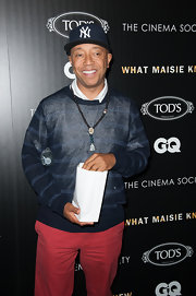 Russell Simmons chose a preppy look at the screening of 'What Maisie Knew' where he wore this striped sweater and colorful pants.