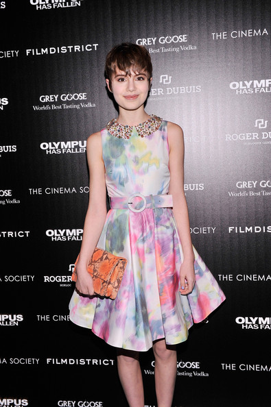 Sami Gayle's orange snakeskin clutch at the 'Olympus Has Fallen' screening provided a bold contrast to her delicate dress.