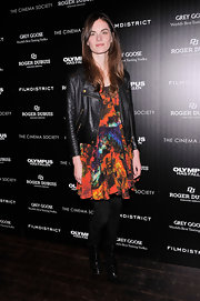 Anouck Lepere added some edge to her bright dress with a classic leather jacket.