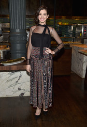 A Valentino tribal-print maxi skirt with sheer inserts completed Anne Hathaway's head-turning attire.