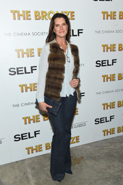 Brooke Shields teamed a brown fur vest with a pale-blue button-down and flare jeans for the screening of 'The Bronze.'