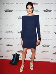 Michelle looks sleek and stunning styled in Rachel Roy. This shoe is perfect for her blue dress and pale tone.