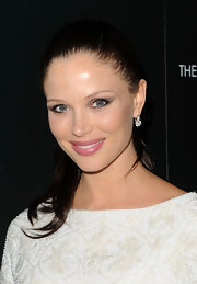 Georgina Chapman pulled her long brown locks back in a sleek bun.