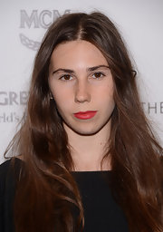 Zosia Mamet added a nice punch of color to her look with this red lipstick.