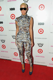 Amber showed off her sultry curves in a printed jumpsuit.