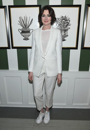 For her footwear, Anne Hathaway got a little funky with a pair of white leather sneakers.