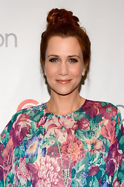 Kristen Wiig chose a stylish top knot for her red carpet look at CinemaCon.
