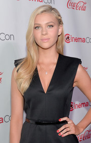 Nicola Peltz wore red nail polish for a bit of color to her dark outfit at the CinemaCon Big Screen Achievement Awards.
