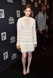 Kate Mara opted for gold accessories, including a pair of Jimmy Choo skinny-strap sandals and a box clutch.