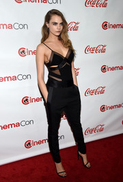Cara Delevingne toned the sexiness down a notch with a pair of tapered black tuxedo pants, also by Alexandre Vauthier.