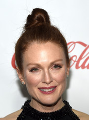 Julianne Moore went for a youthful, funky vibe with this top knot at the CinemaCon Big Screen Achievement Awards.