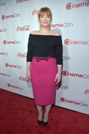 Bryce Dallas Howard brightened up her look with a magenta pencil skirt by Roland Mouret.