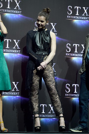 Hailee Steinfeld finished off her eclectic outfit with black lace pants.
