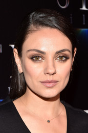 Mila Kunis looked elegant with her sleek side-parted hairstyle during CinemaCon 2017.