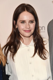 Felicity Jones went for a casual center-parted style when she attended CinemaCon 2018.