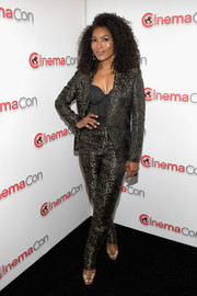 Angela Bassett looked sassy and stylish in a dotted pantsuit by Dzojchen at CinemaCon 2018.