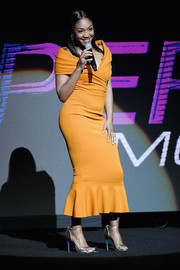 Tiffany Haddish showed off her figure in a fitted orange off-the-shoulder dress while speaking onstage at CinemaCon 2018.