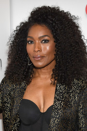 Angela Bassett rocked a side-parted afro at CinemaCon 2018.