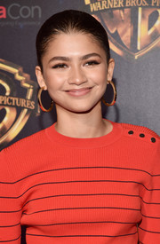 Zendaya Coleman punched up her look with a pair of oversized gold hoops by Jennifer Fisher.