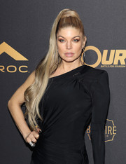 Fergie attended DJ Khaled's birthday celebration wearing a stylish side-swept ponytail.
