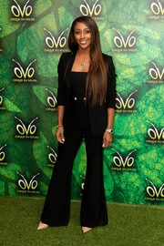 Alexandra Burke kept it smart in a black wide-leg pantsuit at the premiere of 'Cirque du Soleil OVO.'