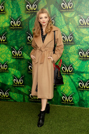 Natalie Dormer teamed black leather ankle boots with a camel-colored coat for the premiere of 'Cirque du Soleil OVO.'
