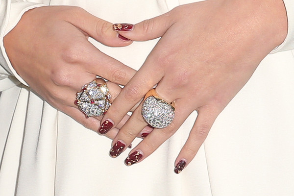 Selena Gomez rocks ornate red nail polish with gold speckled details at the City of Hope Gala