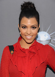 Kourtney Kardashian pulled her long locks up in a high twisted bun for the 2011 Spirit of Life Awards.