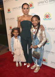Melanie Brown cut a sleek silhouette in a strapless green peplum jumpsuit at the City Year Los Angeles Spring Break.