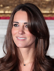 Kate Middleton added a little shine to her look with shimmering lip gloss.