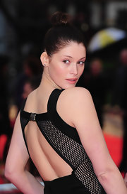 "Gemma Arterton was a head turner at the ""Clash of The Titans"" premiere. She showed off her cut-out mesh dress by pulling her hair up in a bun."
