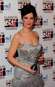 Angela Gheorghi showed off her voluminous updo while attending the BRIT Awards in London, England.