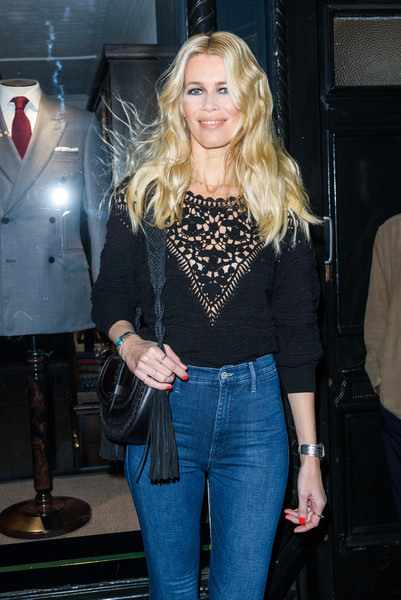 Claudia Schiffer accessorized with a Western-chic shoulder bag during her book signing.