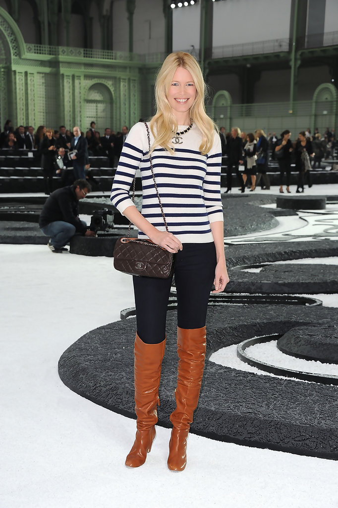 81b4de07323 Claudia Schiffer paired her breton striped sweater with tan over-the-knee  boots.