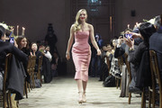 Amanda Seyfried sported a curvy silhouette in a strapless pink frock by Zac Posen during the Muse party in Seoul.