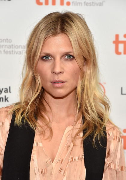 Clemence Poesy Long Wavy Cut [the ones below,hair,face,blond,hairstyle,lip,eyebrow,layered hair,long hair,beauty,chin,clemence poesy,photo call,photo call,tiff bell lightbox,toronto,canada,toronto international film festival]