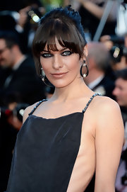 Milla Jovovich chose a twisted bun to give her a fun and edgy 'do to match her gown at the 'Cleopatra' premiere in Cannes.
