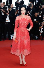 This red lace frock had a lovely cinched waist and full skirt to give Dita Von Teese a classic lady like look.