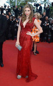 Carly Steel rocked a bold crimson red beaded gown on the red carpet of the premiere of 'Cleopatra.'