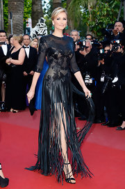 Adriana Karembeu brought out her edgy side with this black embroidered dress that featured a fringed skirt.