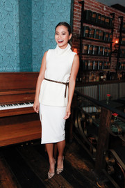 Jamie Chung completed her all-white outfit with a side-slit pencil skirt.