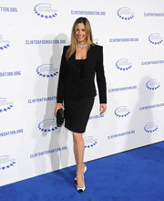 Mira Sorvino looked super-polished and elegant in her ruffled black skirt suit.