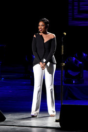 Jennifer Hudson performed at the 'Clive Davis: The Soundtrack of Our Lives' premiere concert wearing a sculptural black off-the-shoulder top.