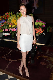 Leslie looked especially lovely at the launch of Rouge in this creamy draped blouse.