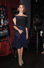 Rebecca Hall went for structured elegance on the red carpet when she wore this navy blue flared dress with an off-the-shoulder shrug sleeve.