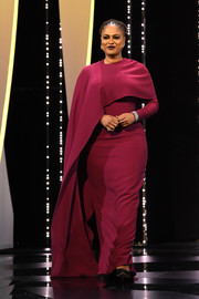 Ava DuVernay chose a caped burgundy column dress by Stella McCartney for the 2018 Cannes Film Festival closing ceremony.