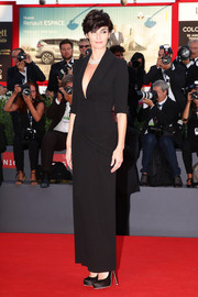 Paz Vega went for sleek elegance in a black tuxedo gown by Ulyana Sergeenko Couture during the Venice Film Festival closing ceremony.