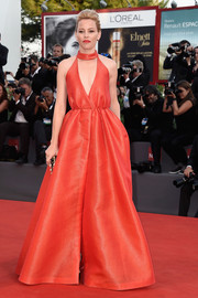 Elizabeth Banks went for bold glamour in a plunging red ball gown by Emilia Wickstead  at the Venice Film Festival closing ceremony.